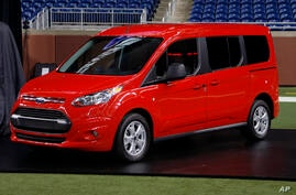 FILE - In this Dec. 14, 2012 file photo, the 2014 Ford Transit Connect wagon is on display at Ford Field in Detroit. Ford Motor…