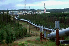FILE - In this undated file photo the Trans-Alaska pipeline and pump station north of Fairbanks, Alaska is shown. Congressional…
