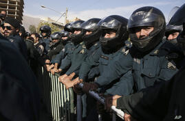 Iranian police officers protect the Saudi Arabian Embassy in Tehran, Iran, Sunday, Sept. 27, 2015, during a gathering of…