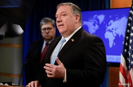 U.S. Secretary of State Pompeo speaks while Attorney General William Barr listens during a joint briefing about the International Criminal Court in Washington