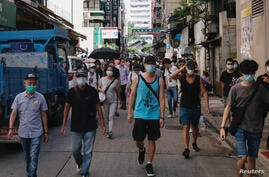 Pro-democracy protesters march against the looming national security legislation in Hong Kong