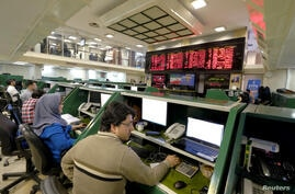 FILE PHOTO: Stock market employees work at Tehran's Stock Exchange in Tehran