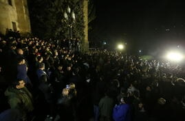 People gather outside the parliament in Yerevan