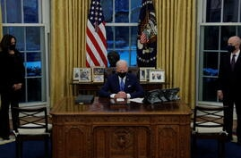 U.S. President Joe Biden signs executive orders on immigration at the White House in Washington