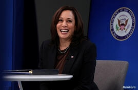 FILE PHOTO: U.S. Vice President Harris delivers a keynote address to the House Democratic Caucus virtually on camera from the White House in Washington