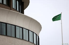 FILE PHOTO: The flag of Saudi Arabia flies above the Saudi Arabia embassy near the Watergate Complex in Washington