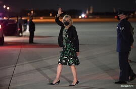 U.S. First Lady Jill Biden waves as she deplanes upon arrival at Andrews Air Force Base in Maryland