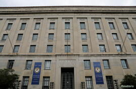 Signage is seen at the headquarters of the United States Department of Justice (DOJ) in Washington, D.C., U.S.