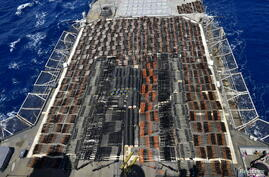 Thousands of illicit weapons is displayed onboard the guided-missile cruiser USS Monterey (CG 61) which was seized from a stateless dhow in international waters of the North Arabian Sea