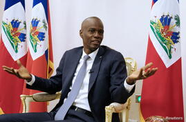 FILE PHOTO: Haiti's President Jovenel Moise speaks during an interview with Reuters at the National Palace of Port-au-Prince