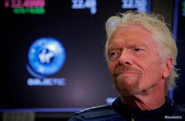 FILE PHOTO: Sir Richard Branson stands on floor of the NYSE  as Virgin Galactic (SPCE) begins public trading in New York