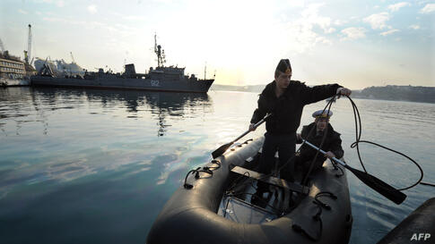 Ukrainian sailors from naval ship Ternopil moor a boat to the pier in Sevastopol bay. Ukraine will not intervene militarily in the separatist peninsula of Crimea to avoid exposing its eastern border, Ukraine's acting president said in an interview.