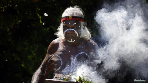 "An Aboriginal man prepares to perform the traditional ""Welcome to Country"" ceremony in Sydney, Australia. The ceremony was performed during the official announcement of the International Union for Conservation of Nature (IUCN) World Parks Congress, whi..."