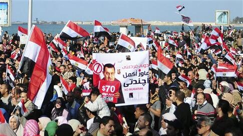 Thousands of Egyptian anti-government protesters march Alexandria, Egypt, Friday, Feb. 11, 2011. Egypt's military threw its weight Friday behind President Hosni Mubarak's plan to stay in office through September elections while protesters fanned out to th