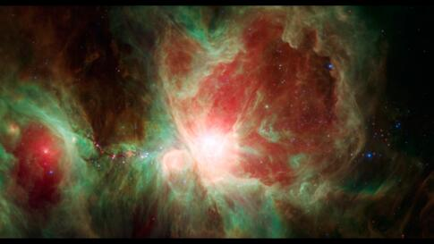 The Orion Nebula, an immense stellar nursery some 1,500 light-years away. This stunning false-color view spans about 40 light-years across the region, constructed using infrared data from the Spitzer Space Telescope.