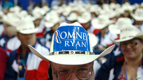 Texas delegate Clint Moore and the rest of Texas delegates fashion their cowboy hats on the floor.