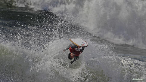 A bodyboarder rides a wave during Sumol Nazare Special Edition in Nazare, Portugal, Mar.19, 2014.