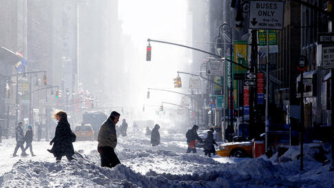 Dec. 27: People walk the streets in Manhattan after a major snowstorm hit the New York City area. (Gary Hershorn/Reuters)