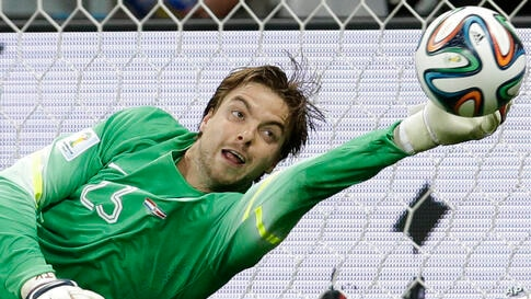 Netherlands' goalkeeper Tim Krul saves the last penalty kick during the World Cup quarterfinal soccer match between the Netherlands and Costa Rica at Arena Fonte Nova in Salvador, Brazil, July 5, 2014.
