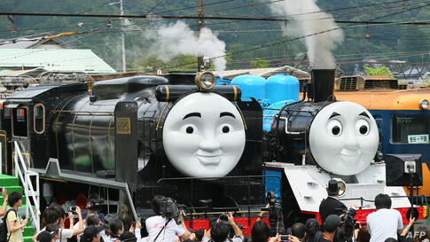 Life-sized Thomas the Tank Engine (R) and Hiro (L) are surrounded by the media, at Senzu station on Japan's Oigawa railway, in the town of Kawanehon in Shizuoka prefecture, west of Tokyo. Rides on popular British character Thomas the Tank Engine will b...