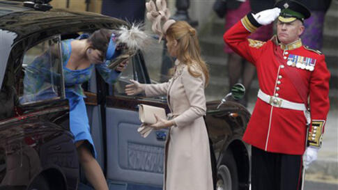 Britain's Princess Beatrice, right, and Britain's Princess Eugenie arrive at Westminster Abbey at the Royal Wedding in London Friday, April, 29, 2011. (AP Photo/Gero Breloer)