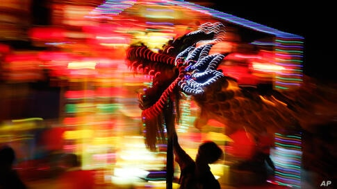 Performers take part in a dragon dance during a night parade to celebrate Chinese New Year in Kuala Lumpur, Malaysia.