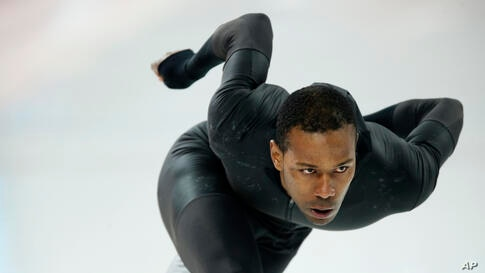 Shani Davis of the U.S. skates in the prototype of the official US Speedskating suit during a training session at the Adler Arena Skating Center at the 2014 Winter Olympics, Feb. 14, 2014.