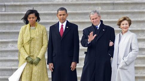 Former President George W. Bush, second from right, waves as he and his wife Laura, right, stand with President Barack Obama, second from left and first lady Michelle Obama as Bush departs from the Capitol after Obama's swearing in as the 44th President o