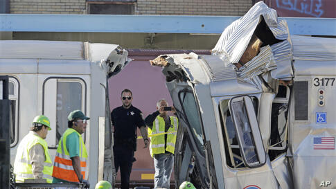 Authorities inspect the wreckage of two Chicago Transit Authority trains that crashed in Forest Park, Ill. The CTA is investigating the cause of the crash, including why the trains were on the same track. A CTA official said 33 people suffered non-life...