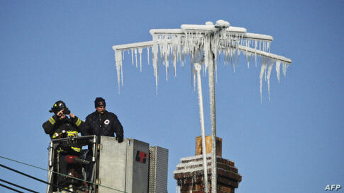 Antennae are covered in ice after firefighters battled a five alarm fire on South Broad Street near Summer Street in Elizabeth, New Jersey, USA. The fire destroyed six businesses. No serious injuries were reported.