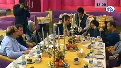 An image grab taken from footage broadcast by Iran's state-run Arabic-language Al-Alam satellite news channel without the permission of the German detainees, shows what the TV said was images of the meeting between German journalists detained in Iran sinc