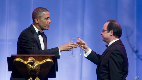 President Barack Obama offers a toast to French President Francois Hollande at the State Dinner at the White House, Feb. 11, 2014.