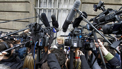 French UMP conservative party member and former minister Nadine Morano, center, addresses reporters outside the French National Assembly in Paris. The leader of former French President Nicolas Sarkozy's conservative party is resigning amid a scandal ov...
