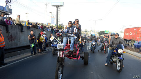 """Bikers take part in the """"Caravana del Zorro"""" (Caravan of the Fox), from Constitution Square in Guatemala City to Esquipulas, 220 km eastward. Some 35,000 motorcyclists marched in a pilgrimage to the Cristo Negro (Black Christ) Basilica, a 53-year-old t..."""