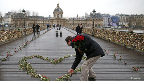 Roses are placed on the Pont des Arts over the River Seine as part on a publicity campaign on Valentine's Day in Paris, France.