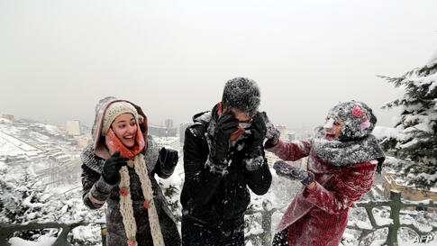 Iranian youths play with snow at Tochal mountain, just north of Tehran. The heaviest snowstorm in five decades has blanketed provinces in northern Iran, cutting power supplies and trapping villagers, Iranian media reported.