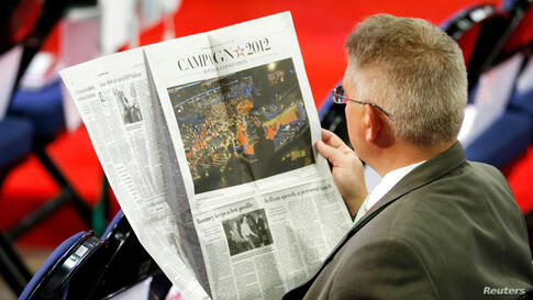 A man reads The Washington Post before the start of the second session of the RNC.