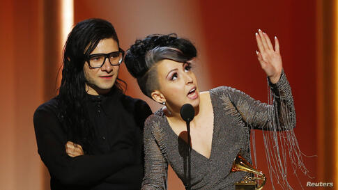 """Skrillex and Sirah (R) accept their award for best dance recording for their work """"Bangarang"""" in 55th annual Grammy Awards in Los Angeles, California, Feb. 10, 2013."""