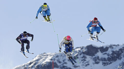 Andreas Matt of Austria, right, performs on his way to win the final of the men's ski cross World Cup event in Val Thorens, French Alps, ahead of Victor Oehling Norberg of Sweden, second right, who finished second, Jean Frederic Chapuis of France, left...