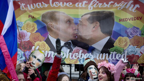 Protesters take part in a demonstration against Russia's 'anti-gay' laws outside the Embassy of the Russian Federation in London.