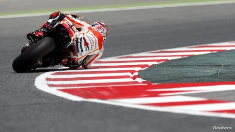 Honda MotoGP rider Marc Marquez of Spain takes a curve during the second free practice at the Catalunya Grand Prix in Montmelo, near Barcelona.