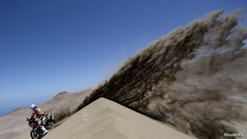 Spain's Jordi Viladoms rides his KTM motorcycle during the ninth stage of the Dakar Rally 2014, from Calama to Iquique, Chile, Jan. 14, 2014.