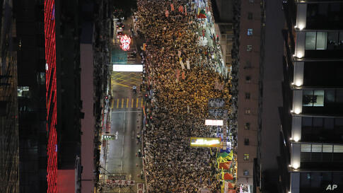 Residents marched through the streets of downtown Hong Kong to push for greater democracy.
