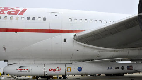 """The Orbital Sciences Pegasus XL rocket with NASA's NuSTAR spacecraft is attached to the L-1011 carrier aircraft known as """"Stargazer,"""" June 2, 2012. (NASA)"""