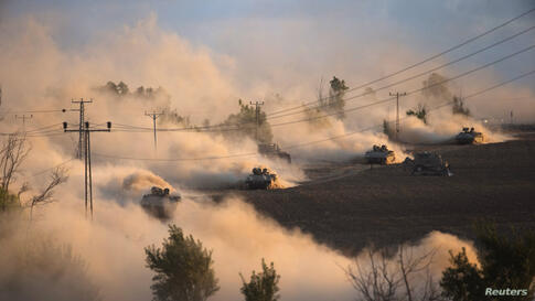 "Israeli tanks maneuver outside the northern Gaza Strip. Israel intensified its land offensive in Gaza with artillery, tanks and gunboats on Friday and warned it could ""significantly widen"" the operation."