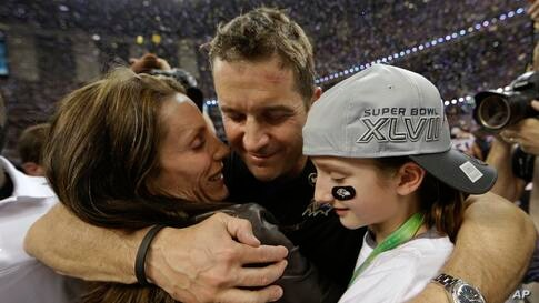 Baltimore Ravens head coach John Harbaugh hugs his wife Ingrid, left, and daughter Alison after defeating the San Francisco 49ers in the Super Bowl in New Orleans.