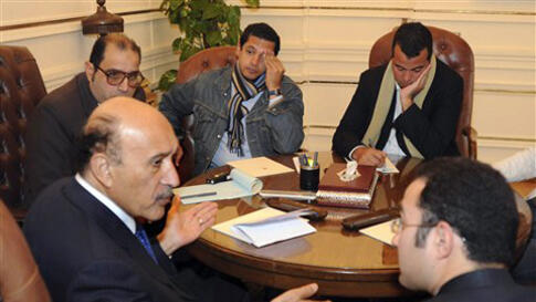 Egyptian Vice President Omar Suleiman, center, meets with representatives of protesters of 25th January movement in Cairo, Egypt, Sunday, Feb. 6, 2011. Egypt's largest opposition group, the Muslim Brotherhood, said it would begin talks Sunday with the gov