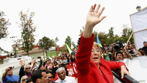 Chilean presidential candidate Michelle Bachelet waves to her supporters during a campaign event in Santiago. Bachelet was the clear winner in the presidential election, although she will have to wait until a second round runoff next month to seal her ...