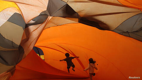 Children play inside inflatable installations at the Casa Daros museum in Rio de Janeiro.