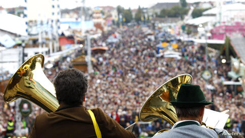 Members of a brass band wearing traditional Bavarian clothes play for a concert at the 180th Oktoberfest beer festival in Munich. Millions of visitors from around the world will come to Oktoberfest, which runs until Oct. 6, 2013.
